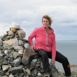 Petra sitting on cairn on Horn Head on north-west coast of Donegal.